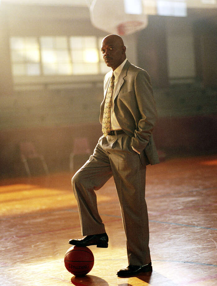 "In this photo provided by Paramount Pictures, Samuel L. Jackson as coach Ken Carter in ""Coach Carter,""  based on a true story of a controversial high-school basketball coach, who received both high praise and staunch criticism  for benching his entire undefeated basketball team for poor academic performance.  (AP Photo/Paramount Pictures/Tracy Bennett) Photo: TRACY BENNETT, AP Photos / AP2005"