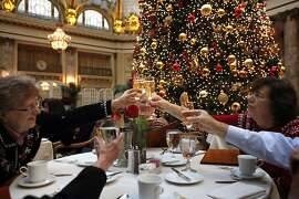 Margaret B.Campos, no in picture, toasts family Margaret M. Campos, left  Beth Ludwig, Kathleen Campos and Richard Campos, not as they celebrate for the fourth year a Christmas lunch in the garden court at the Palace Hotel Friday,  December 20, 2013 in San Francisco, Calif.