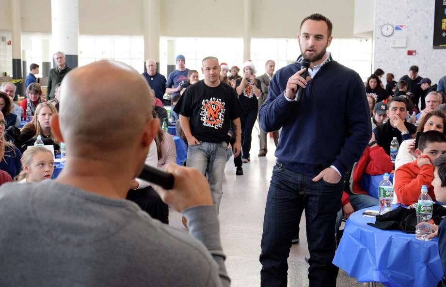 Anthony Mulvaney from Ridgefield asks New York Yankees pitching great Mariano Rivera a question during a question and answer session. Rivera visited Ridgefield High School on Saturday Dec. 21,2013 to raise funds for his foundation. Photo: Lisa Weir / The News-Times Freelance
