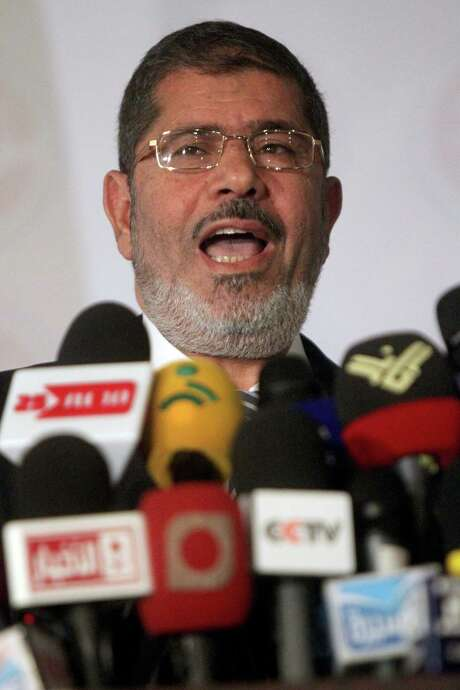 Ex- President Mohamed Morsi will stand trial for his role in the 2011 revolt against Hosni Mubarak. Photo: KHALED DESOUKI, Staff / AFP