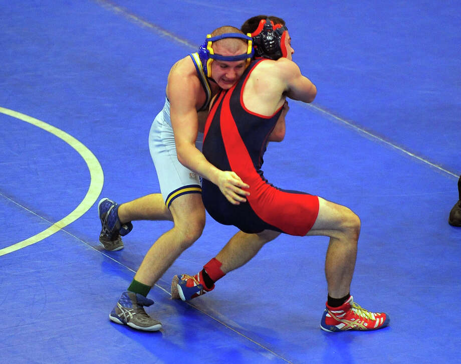 Wrestling action at the Fairfield Ludlowe Wrestling Invitational in Fairfield, Conn. on Saturday December 21, 2013. Photo: Christian Abraham / Connecticut Post