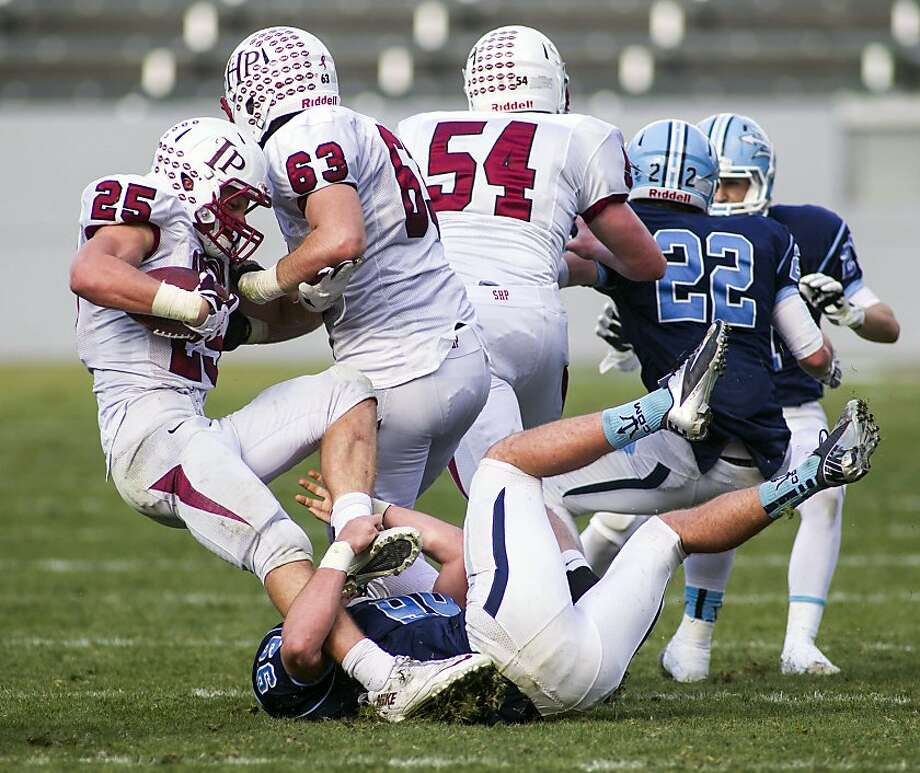 Sacred Heart Prep junior Ben Burr-Kirven - who had his team's lone offensive TD - is tackled by Parker Chase. Photo: Ringo H.W. Chiu, Associated Press