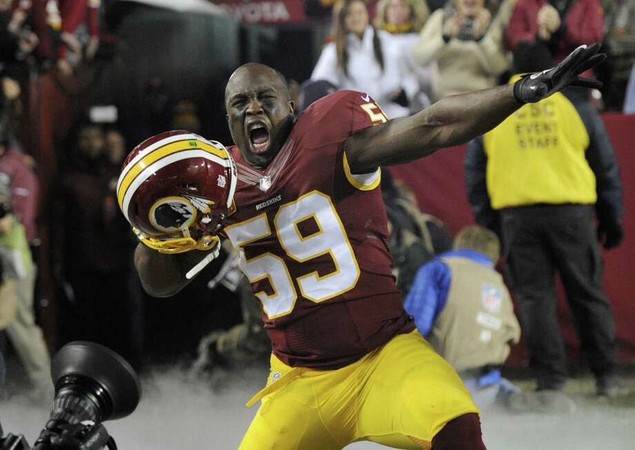 Redskins linebacker London Fletcher, who is expected to retire at season's end, has played in 254 straight games, the longest active streak in the NFL. In 14 games against the Cowboys, Fletcher has 120 tackles, three sacks, three INTs, three forced fumbles and nine passes defended. Photo: Nick Wass / Associated Press / FR67404 AP