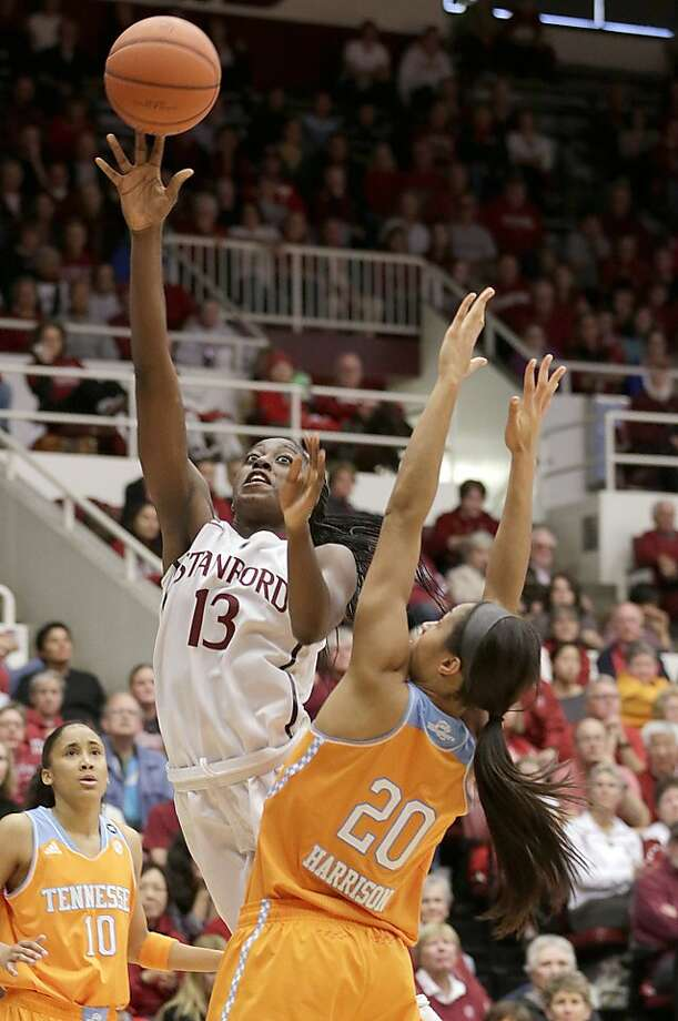 Chiney Ogwumike shoots between Tennessee's Meighan Simmons (10) and Isabelle Harrison en route to 32 points. Photo: Tony Avelar, Associated Press