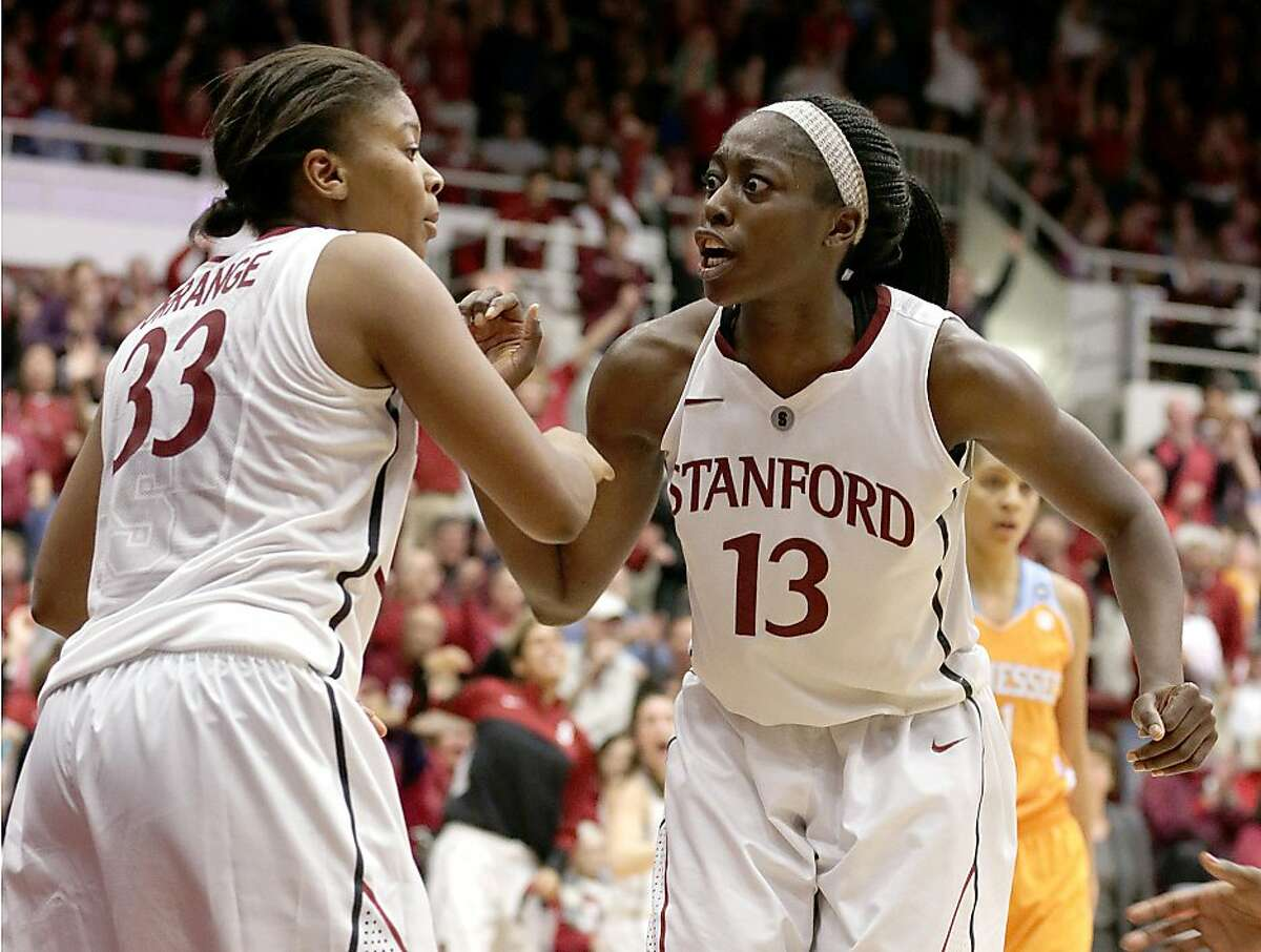 Stanford guard Amber Orange (33) celebrates with forward Chiney Ogwumike (13) after Amber made a last-minute shot against Tennessee during the second half of an NCAA college basketball game, Saturday, Dec. 21, 2013, in Stanford, Calif. Stanford won 76-70. (AP Photo/Tony Avelar)
