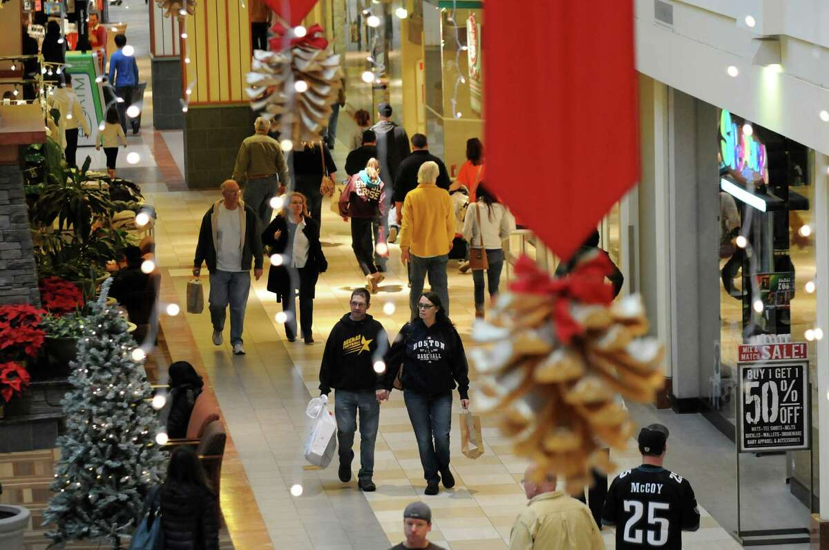 Shoppers walk through the mall with their purchases on Saturday, Dec. 21, 2013, at Colonie Mall in Colonie, N.Y (Cindy Schultz / Times Union)