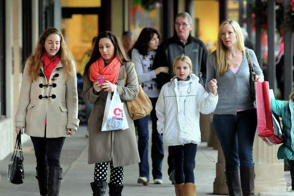 Shoppers walk with their purchases
