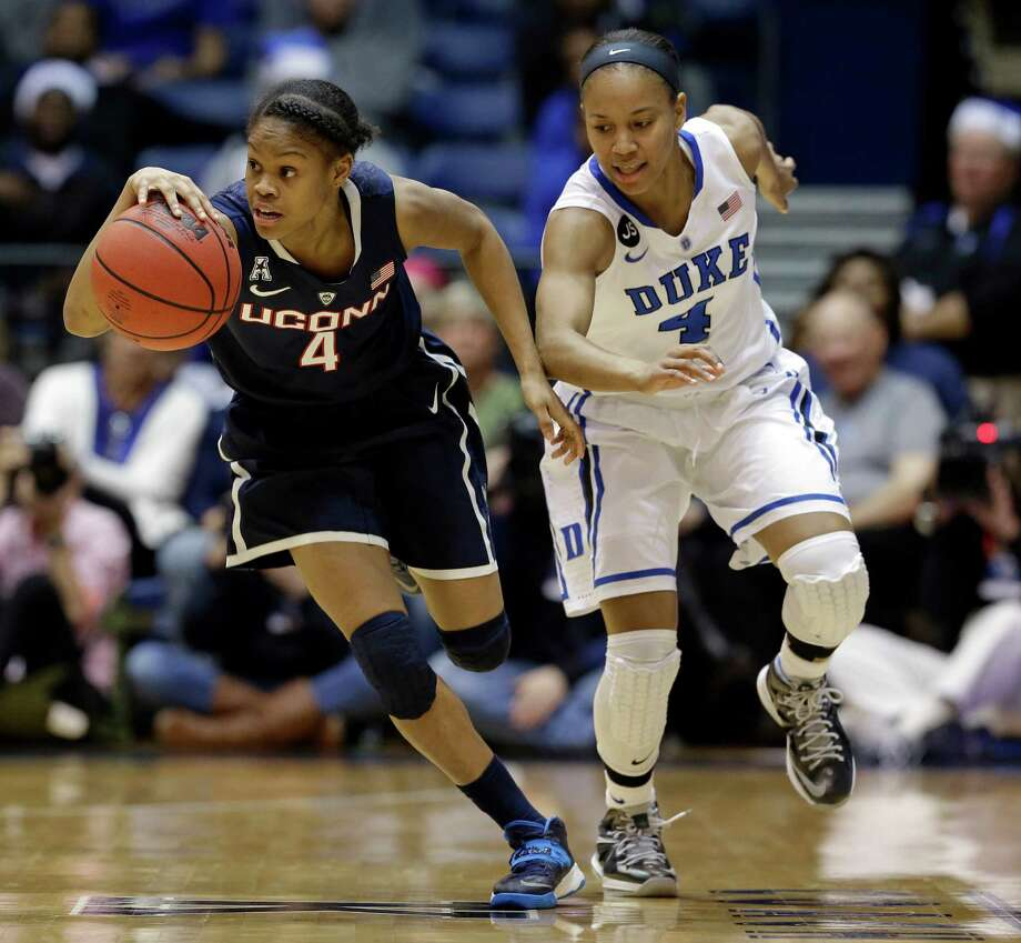 Duke's Chloe Wells, right, chases Connecticut's Moriah Jefferson, left,  during the second half of an NCAA college basketball game in Durham, N.C., Tuesday, Dec. 17, 2013. Connecticut won 83-61.(AP Photo/Gerry Broome) Photo: Gerry Broome, Associated Press / Associated Press