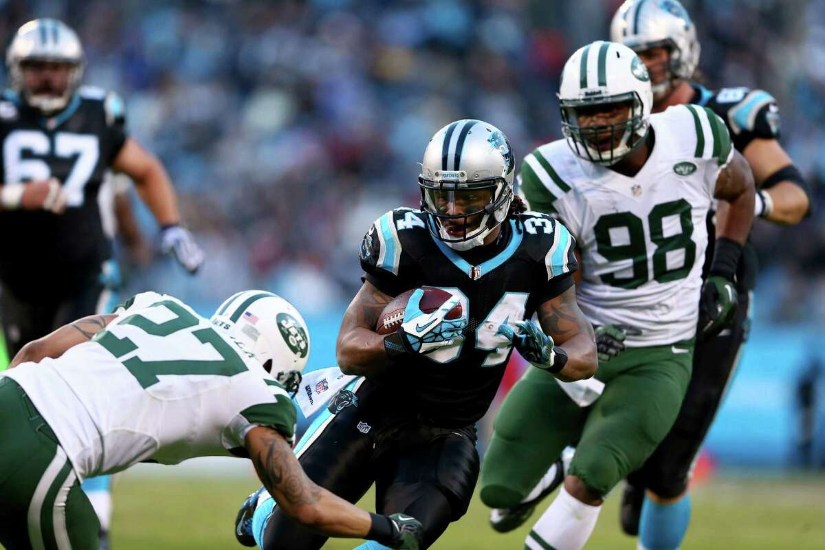 CHARLOTTE, NC - DECEMBER 15: Dee Milliner #27 of the New York Jets tries to stop DeAngelo Williams #34 of the Carolina Panthers during their game at Bank of America Stadium on December 15, 2013 in Charlotte, North Carolina. (Photo by Streeter Lecka/Getty Images)