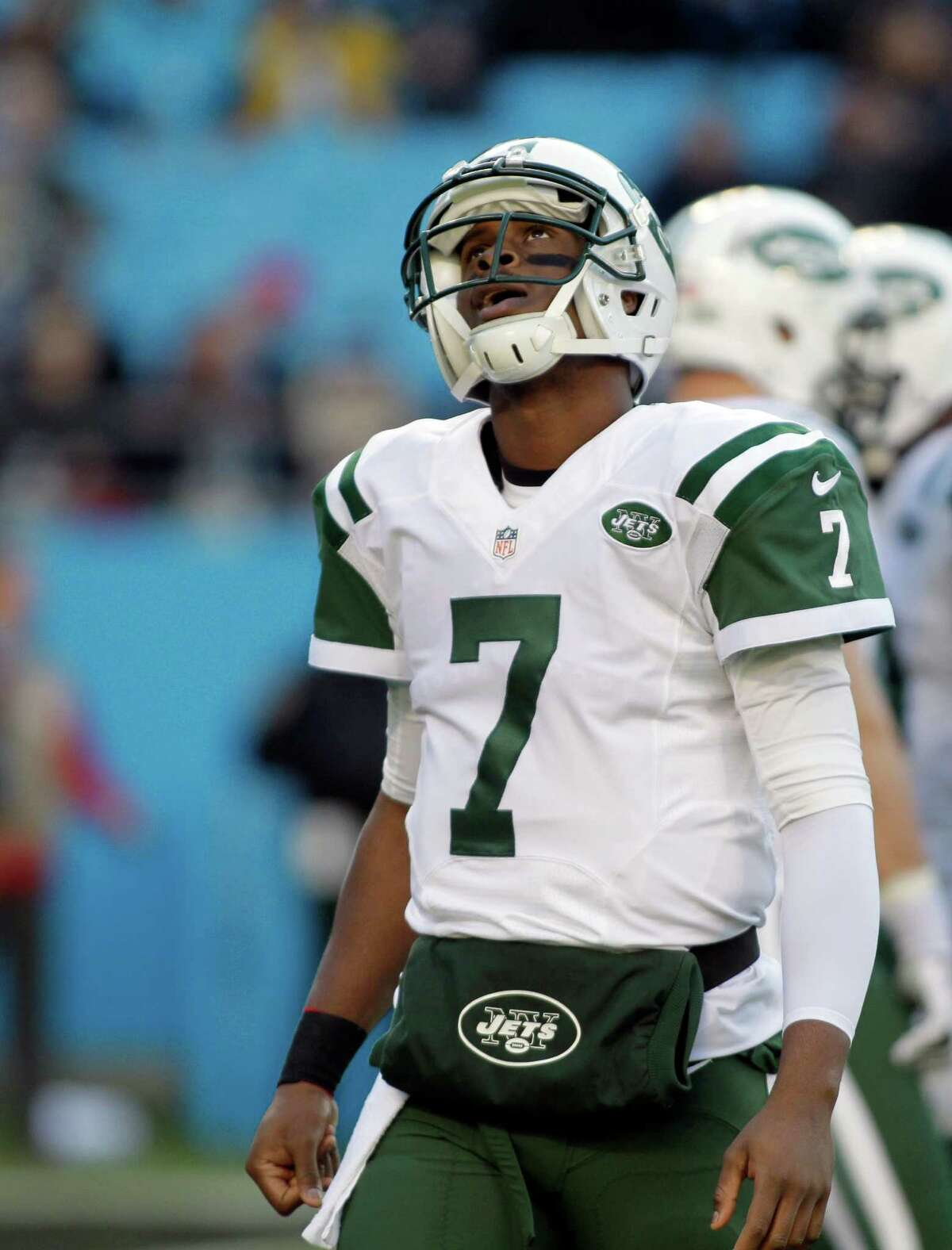 New York Jets quarterback Geno Smith (7) looks up after being sacked by the Carolina Panthers during the first half of an NFL football game in Charlotte, N.C., Sunday, Dec. 15, 2013. (AP Photo/Bob Leverone) ORG XMIT: NCCB105