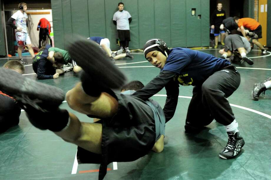 Wrestlers Alexis Porter, 17, right, and her brother Jesse Porter, 16, practice wrestling moves on Thursday, Dec. 19, 2013, at Shenendehowa High in Clifton Park, N.Y (Cindy Schultz / Times Union) Photo: Cindy Schultz / 00025112A