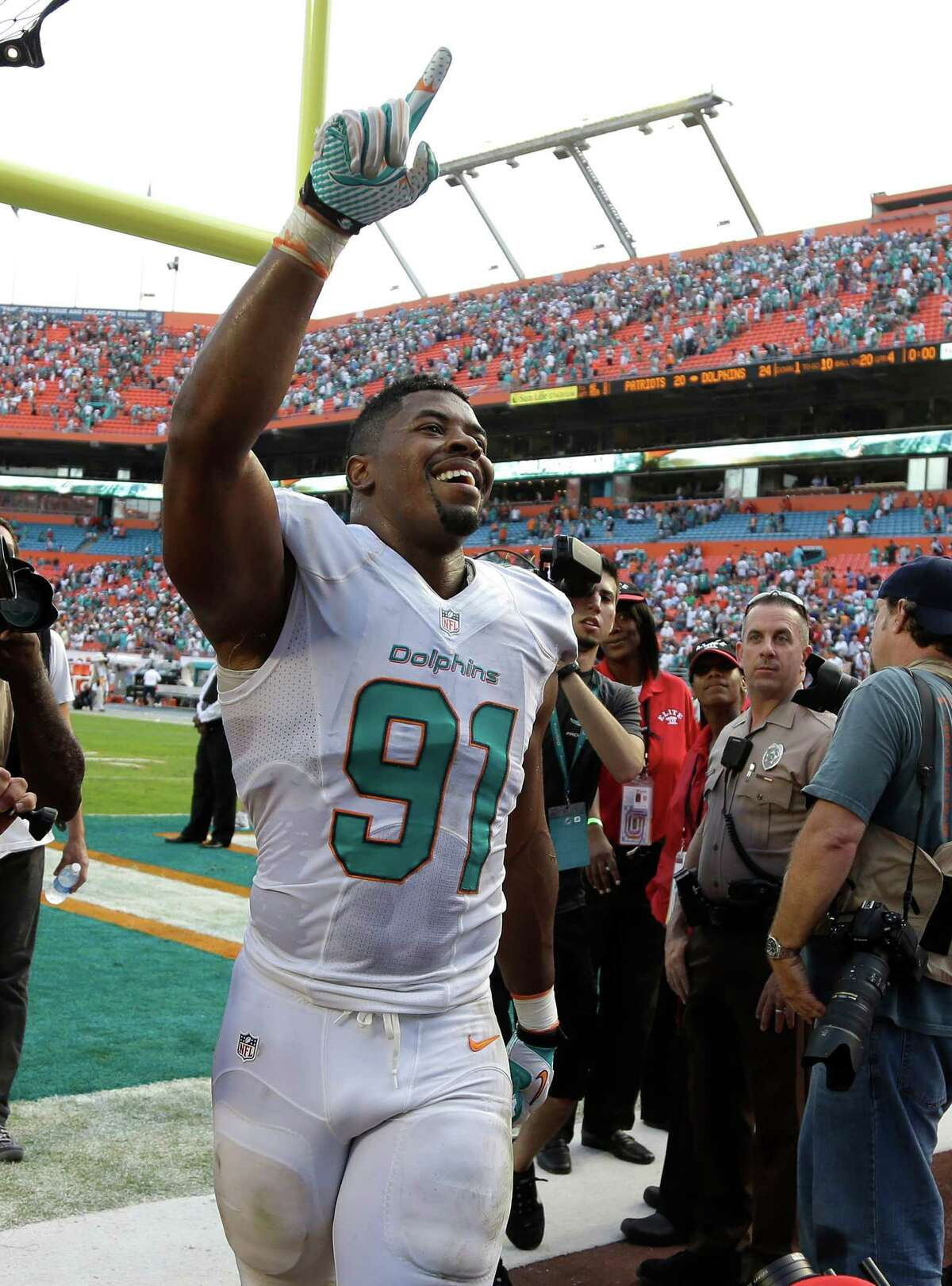 Miami Dolphins defensive end Cameron Wake (91) walks off the field after the Dolphins defeated the New England Patriots 24-20 in an NFL football game on Sunday, Dec. 15, 2013, in Miami Gardens, Fla. (AP Photo/Lynne Sladky) ORG XMIT: SLS121