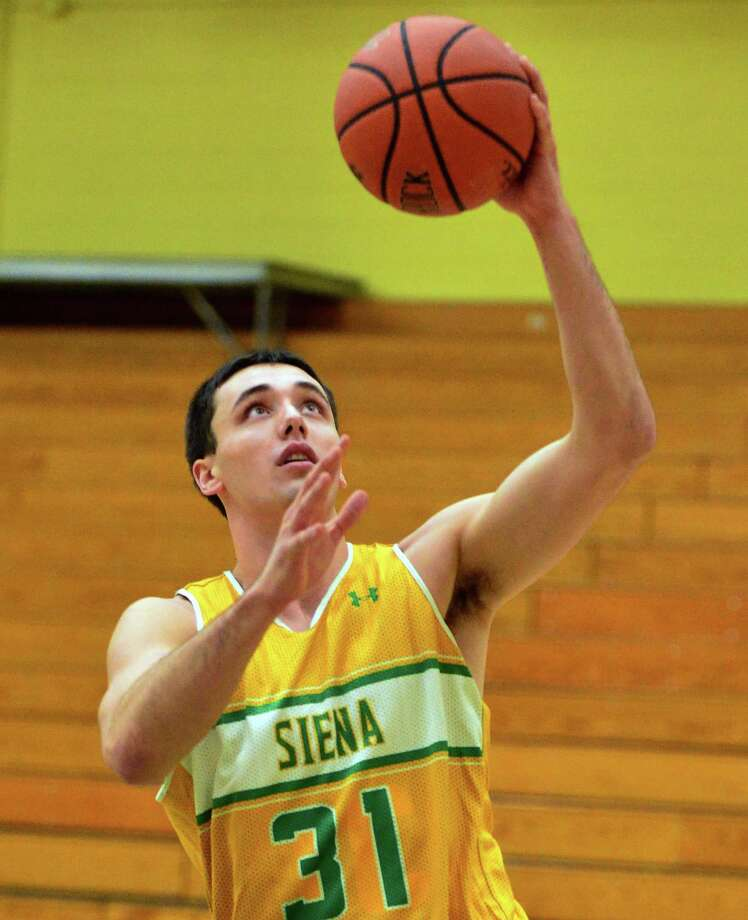 Siena's Brett Bisping during practice Saturday Dec. 21, 2013, in Colonie, NY.  (John Carl D'Annibale / Times Union) Photo: John Carl D'Annibale / 00025113A