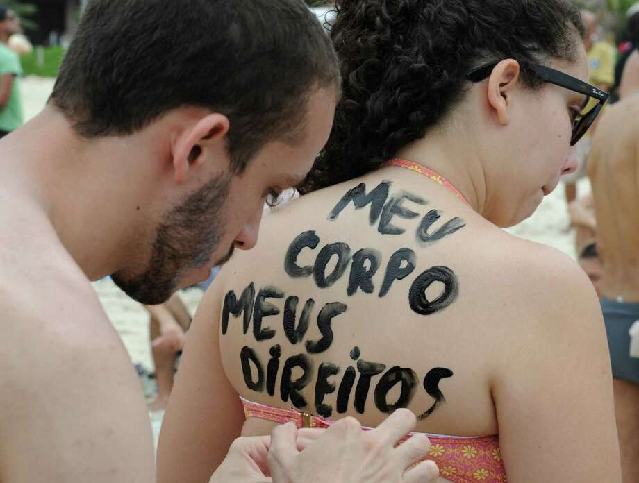 """Brazilians gather on Rio de Janeiro's Ipanema beach to protest a law that criminalizes going topless on the city's famous beaches. The Portuguese body paint reads: """"My body, my rights."""" Photo: Tasso Marcelo / Getty Images / TASSO MARCELO"""