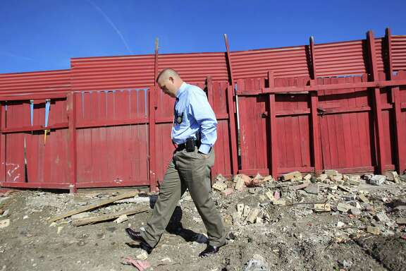 Steve Roskey, the Texas Alcoholic Beverage Commission  agent whose work was key to the latest round of indictment in a major Houston-based human trafficking, walks through the rubble of the demolished La Costenita bar on Thursday, Dec. 12, 2013, in Houston. Steve Roskey also rescued an infant child who was being held by a trafficker as a way to coerce one of the victims into compliance.