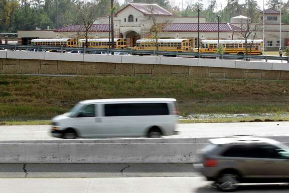 Traffic moves along the Hardy Toll Road past Northgate Crossing Elementary in Spring. The school is one of 127 in the region located close enough to a major roadway to pose a pollution risk to students.