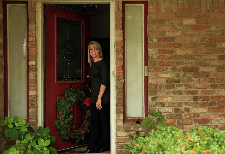 Rhonda Compton sold her condo in the Energy Corridor after attempting to sell it for the last three years during the recession on Thursday, Dec. 19, 2013, in Houston. ( Mayra Beltran / Houston Chronicle ) Photo: Mayra Beltran, Staff / © 2013 Houston Chronicle