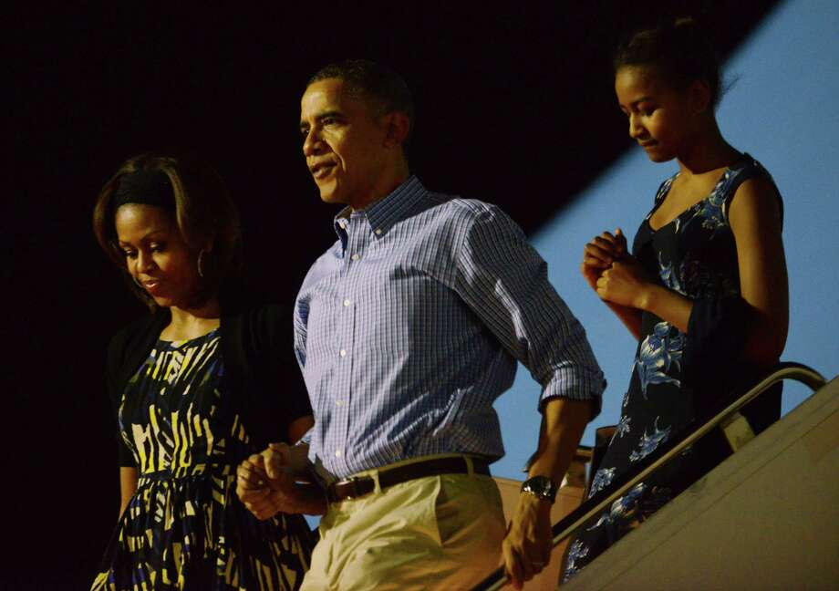 President Barack Obama, first lady Michelle Obama and daughter Sasha arrive at Joint Base Pearl Harbor-                   Hickam in Hawaii for a family vacation Saturday. Photo: Cory Lum / McClatchy-Tribune News Service / Abaca Press