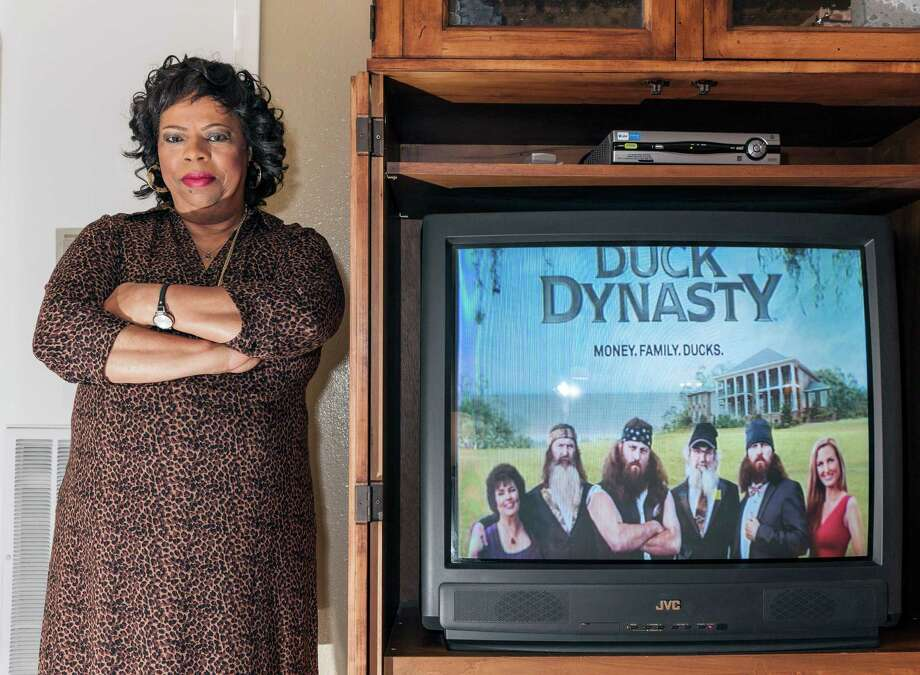 Column on Miriam Anderson, a 62-year-old Missouri City registered nurse and avid watcher of the popular A&E Show Duck Dynasty. Originally from West Monroe, La., where the show is set, Anderson felt connected to the characters and their southern way of life. Then came Phil Robertson's comments dismissing black discrimination during Jim Crow. Anderson was also stung by revelations about Paula Deen earlier this year and owns many of Deen's cookbooks, though she hasn't cooked any of Deen's recipes since the news broke. 12/21/13 (Craig H. Hartley/For the Chronicle) Photo: Craig Hartley, Freelance / Copyright: Craig H. Hartley