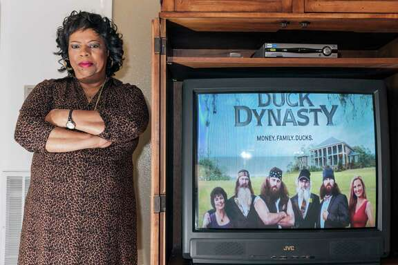 Column on Miriam Anderson, a 62-year-old Missouri City registered nurse and avid watcher of the popular A&E Show Duck Dynasty. Originally from West Monroe, La., where the show is set, Anderson felt connected to the characters and their southern way of life. Then came Phil Richardson's comments dismissing black discrimination during Jim Crow. Anderson was also stung by revelations about Paula Deen earlier this year and owns many of Deen's cookbooks, though she hasn't cooked any of Deen's recipes since the news broke. 12/21/13 (Craig H. Hartley/For the Chronicle)