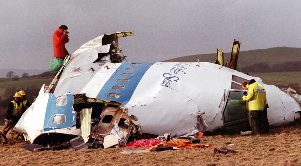 This  Dec. 22, 1988, file photo shows police and investigators looking at what remains of the flight