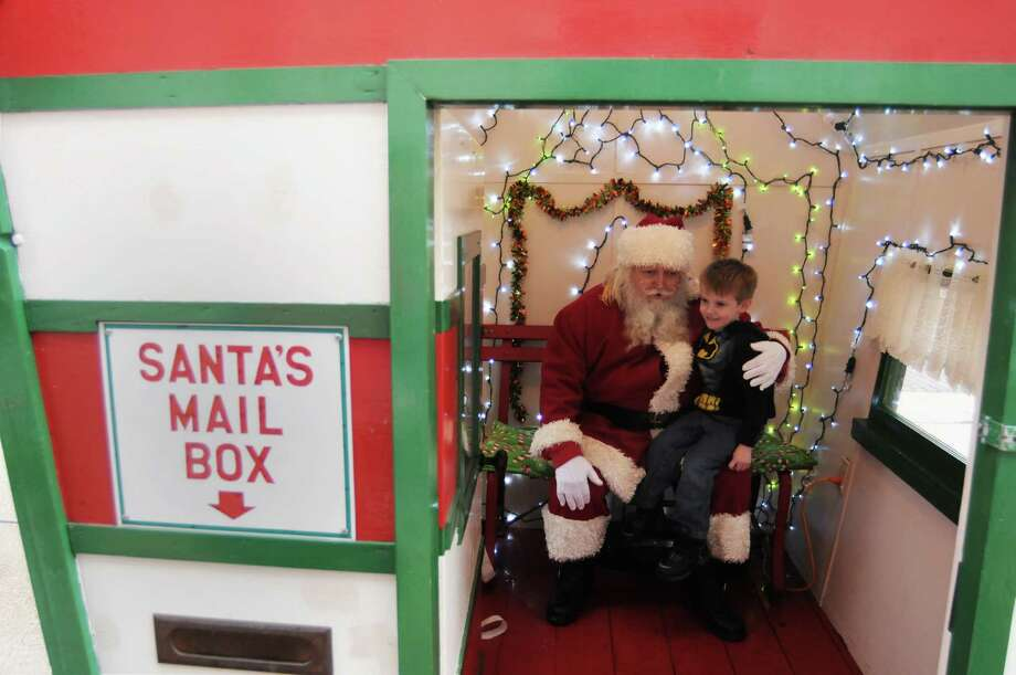 Four-year-old Cannon VanHarn, from Stevensville, Mich., visits with Santa Claus, played by Eric Shriver, from Sawyer, Mich., Saturday, Dec. 21, 2013, at Santa's House in downtown St. Joseph, Mich. Photo: DON CAMPBELL, Associated Press / THE HERALD-PALLADIUM