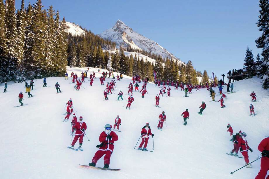 In this hand out image provided by Crested Butte Mountain Resort, shows participants dressed as Santas skiing from Uley's Ice Bar on Crested Butte Mountain, Crested Butte, Colo., for the first 'Santa Ski Crawl' on Saturday, Dec. 14, 2013. There were over 425 in participants in this event. Photo: Nathan Bilow, Associated Press / Crested Butte Mountain Resort