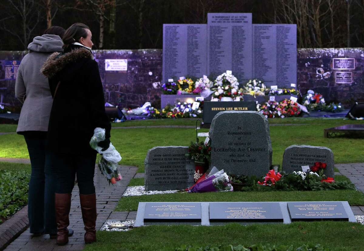 Members of the public view the scene at the main memorial stone in memory of the Lockerbie victims of Pan Am flight 103 bombing in the garden of remembrance at Dryfesdale Cemetery, near Lockerbie, Scotland, Saturday Dec. 21, 2013. Pan Am flight 103 was blown apart above the Scottish border town of Lockerbie on Dec. 21, 1988. All 269 passengers and crew, on the Pan Am flight and 11 people on the ground were killed in the bombing. (AP Photo/Scott Heppell). ORG XMIT: NSH124