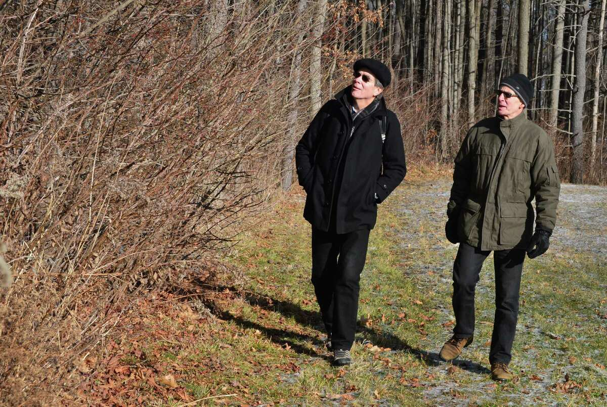 Tom Denny, left, and Rick Fenton of Sustainable Saratoga look at out burning bushes in the Skidmore Campus North Woods Thursday, Dec. 12, 2013, in Saratoga Springs, N.Y. (John Carl D'Annibale / Times Union)