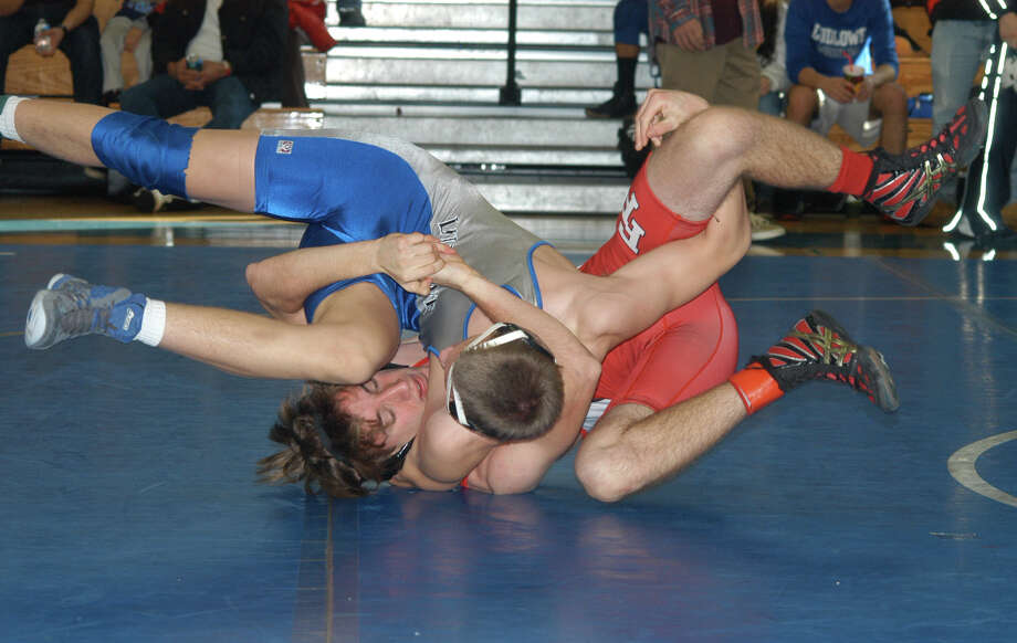Fairfield Ludlowe's Lee Stenild-Johanson, in blue, wresting against Fairfield Prep's Tsiranides Yanni Saturday at the Ludlowe Invitational at Ludlowe. Competition featured 12 teams, including Ludlowe and Fairfield Prep. Photo: Andy Hutchison / Fairfield Citizen