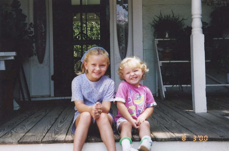 Then:In August of 2000, on a Texas Hill Country camping trip with their grandparents, Heather and Hailee Hutchingson posed on the steps of the Sauer Beckman Living History Farm-House in Lyndon B. Johnson State Park in Stonewall, Texas. Photo: Courtesy Photo / Janice Dahlmann