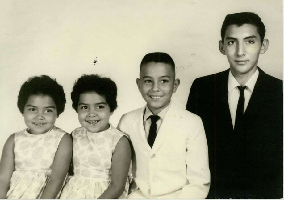 Then: The original photo of the Menchaca kids was taken in August 1964 in Junction, Texas. It includes myself, Belinda, my twin sister, Melinda, my brother Apolonio Jr. and my eldest brother, Edward. Our parents had this photo made in celebration of Edward's graduation. Photo: Courtesy Photo / Belinda Flores