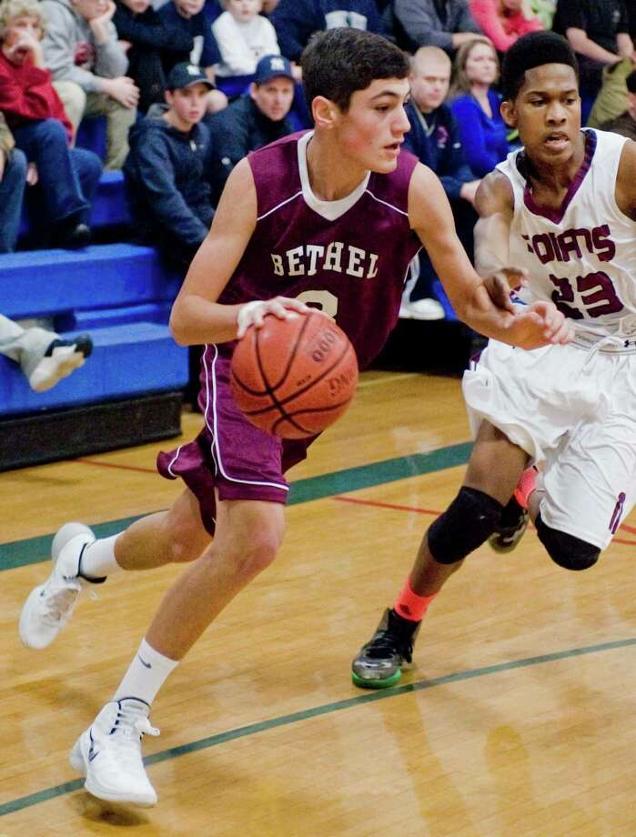 Bethel High School's Leo Eaton moves the ball to the basket in the News-Times Greater Danbury Tip-Off Classic against North Haven High School at the Danbury War Memorial. Saturday, Dec. 21, 2013 Photo: Scott Mullin / The News-Times Freelance