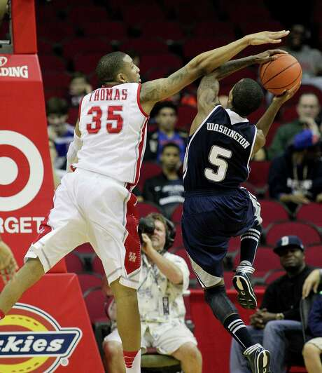 Rice's Washington (5) has his shot attempt blocked by Houston's TaShawn Thomas during Saturday's game at Toyota Center. Thomas finished with three blocks to go with 16 points and 10 rebounds. Photo: Bob Levey, Special To The Chronicle / ©2013 Bob Levey