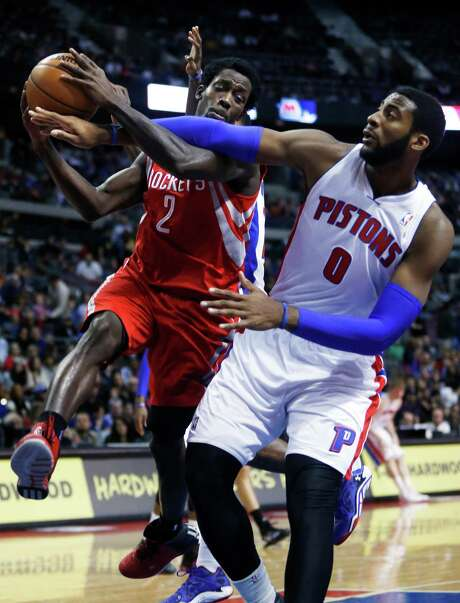 The Rockets' Pat Beverley (2) is fouled by the Pistons' Andre Drummond (0) while going to the basket in the first half of Saturday night's win at Detroit. Photo: Duane Burleson, FRE / FR38952 AP