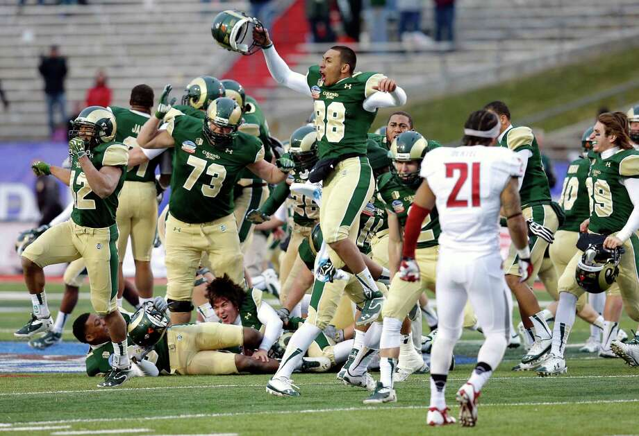 The celebration begins for Colorado State after the Rams rebounded from an eight-point deficit with less than twominutes remaining to tie Washington State with 33 seconds left and then win Saturday's New Mexico Bowl 48-45 on a field goal with three seconds remaining. Photo: Matt York, STF / AP