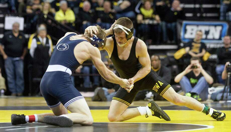 Iowa State wrestling (1975-2000)Iowa's wrestling program has captured 20 national titles over the span of 26 years, including nine undefeated seasons and nine consecutive titles between 1978-1986. Photo: Benjamin Roberts, Associated Press / Iowa City Press-Citizen