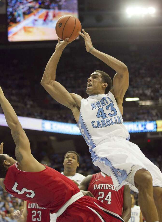 North Carolina's James Michael McAdoo (43) scored 19 points and had seven rebounds in Saturday's overtime win over Jordan Barham and Davidson. Photo: Robert Willett, MBR / Raleigh News & Observer