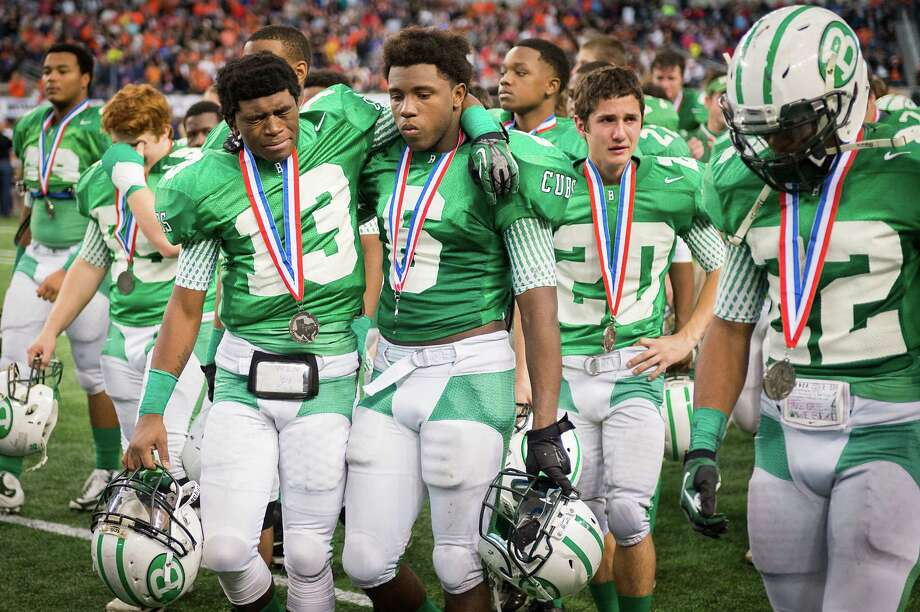 Brenham's Ezavier Newsome (13)  and Tre'Markes Smith (6) took little comfort in knowing they hung with Aledo for three-quarters of Saturday's state title game. Photo: Smiley N. Pool, Staff / © 2013  Houston Chronicle