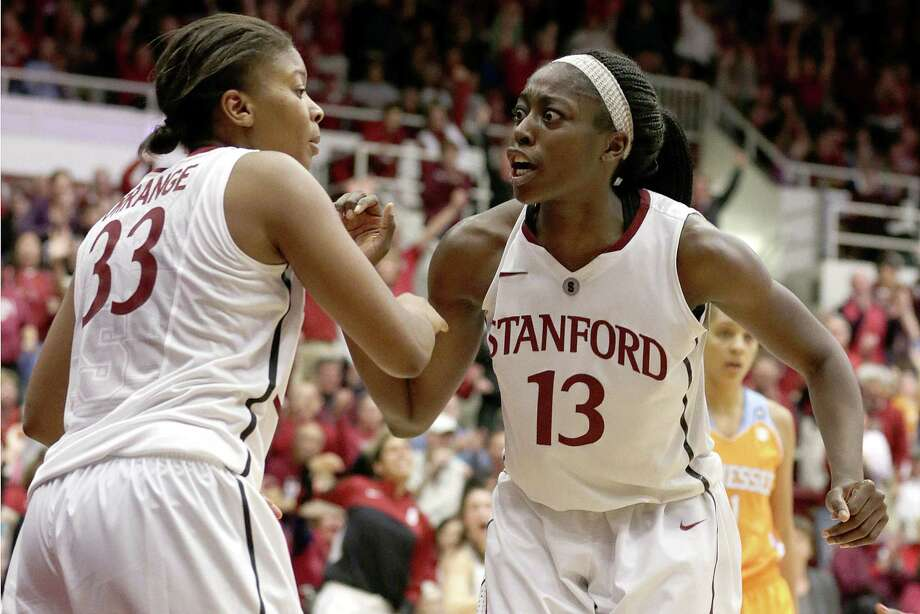 Stanford guard Amber Orrange (left) celebrates with Chiney Ogwumike after Orrange's key basket late in the Cardinal's win over Tennessee. Photo: Tony Avelar / Associated Press / FR155217 AP