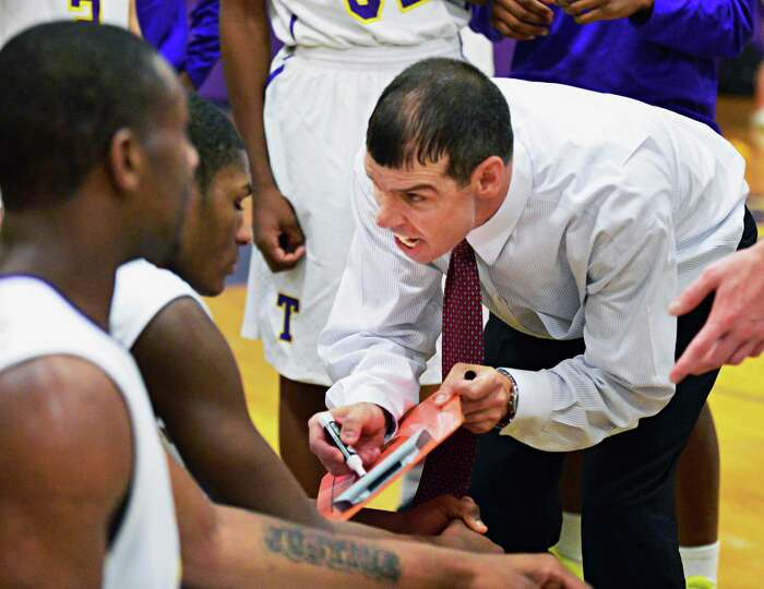 Troy head coach Richard Hurley with players during a time out in Saturday's game against Proctor at