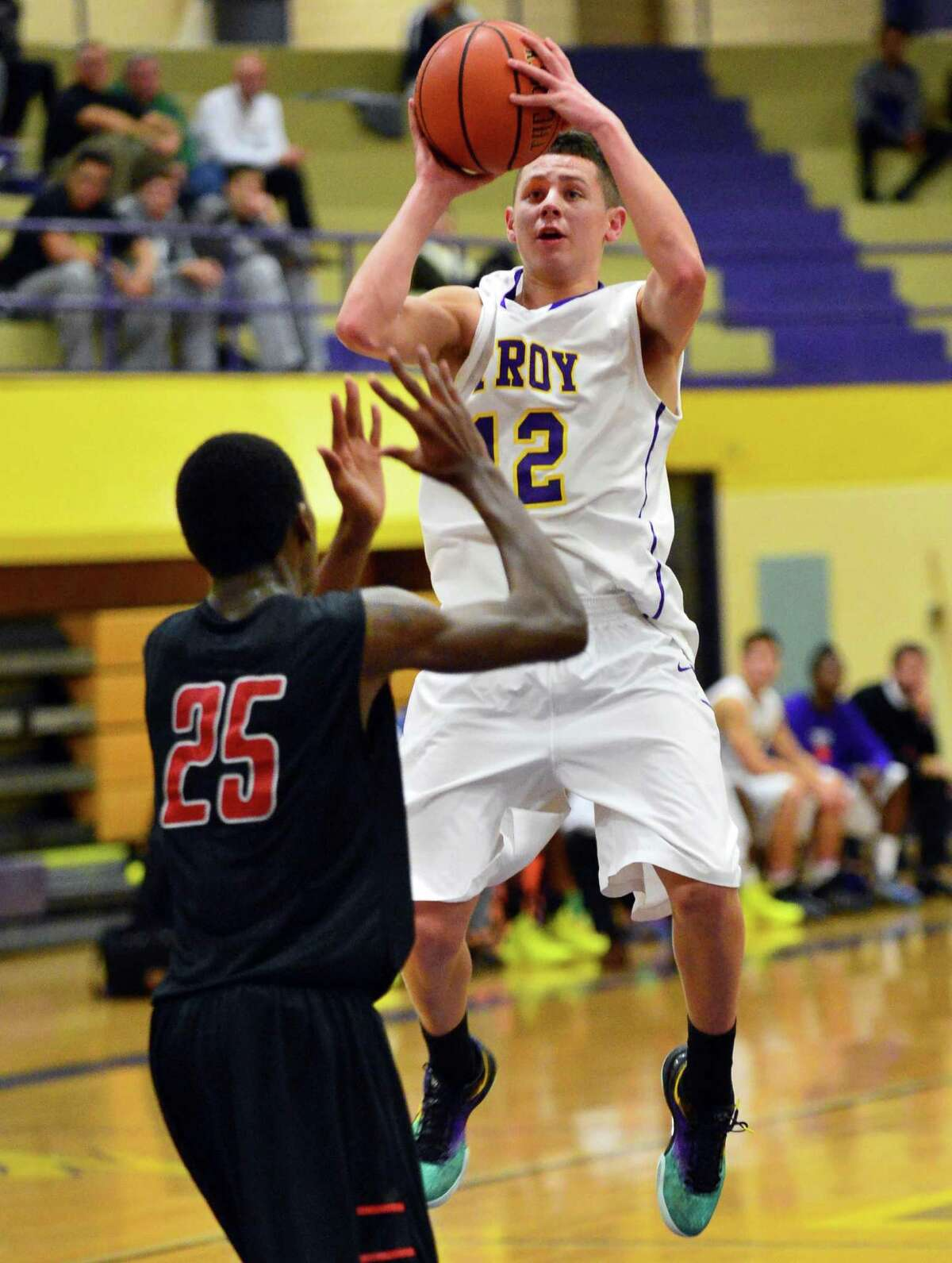 Troy's #12 Zach Radz, at right, shoots past Proctor defender Daquan Testamard during Saturday's game at Troy High Dec. 21, 2013, in Troy, NY. (John Carl D'Annibale / Times Union)