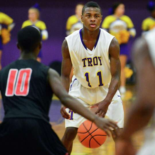 Troy's #11 Dyaire Holt brings the ball down against Proctor during Saturday's game at Troy High Dec.
