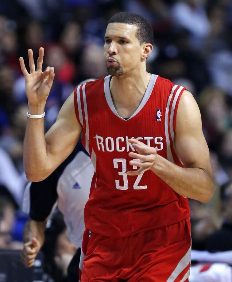 Rockets guard Francisco Garcia (32) gestures after sinking a three-pointer. Photo: Duane Burleson, Associated Press
