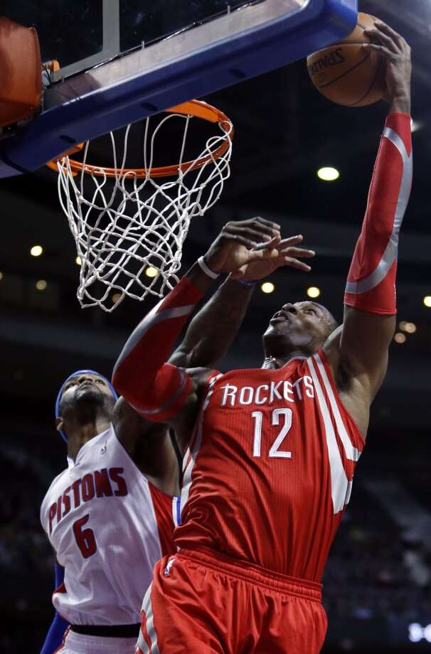 Rockets center Dwight Howard (12) takes a shot against Pistons forward Josh Smith (6). Photo: Duane Burleson, Associated Press