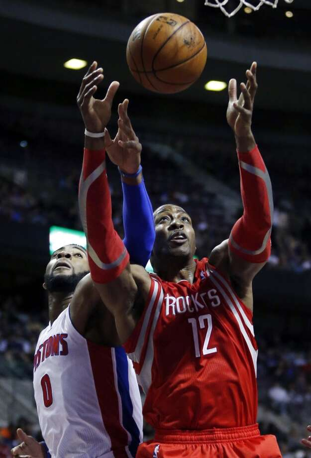 Rockets center Dwight Howard (12) beats Pistons center Andre Drummond (0) to a rebound. Photo: Duane Burleson, Associated Press