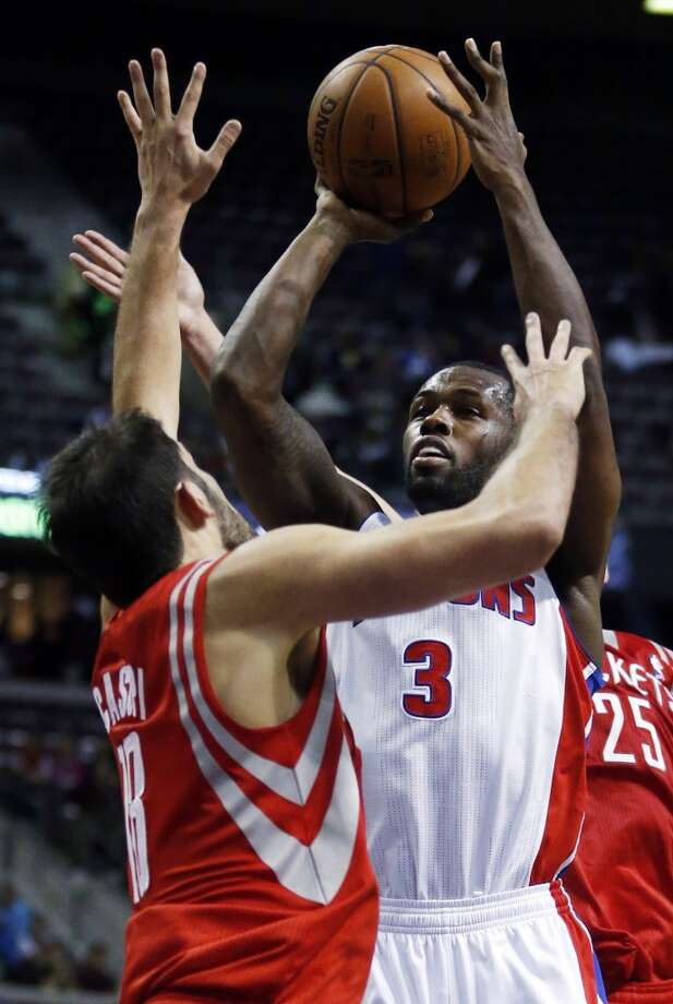 Pistons guard Rodney Stuckey (3) takes a shot against Rockets forward Omri Casspi. Photo: Duane Burleson, Associated Press