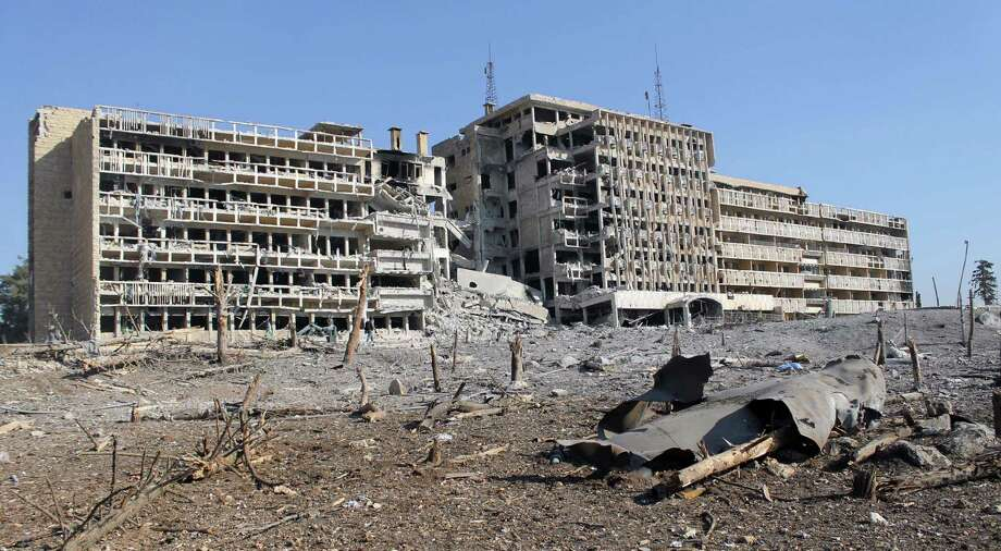 Rebel fighters have seized the ruins of Kendi hospital in the northern Syrian city of Aleppo. The city has been split into rebel- and regime-controlled areas since mid-summer last year. Photo: Mohammed Al-Khatieb / Getty Images / AFP