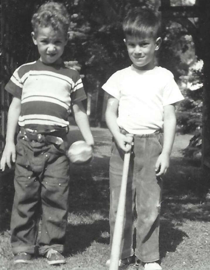 Then:In 1950 Pete Trudell (left) & his Buddy David Aquino where photographed in front of their house in Akron NY. Pete is 12 days older than David. In 1958 Peter's family moved to New Jersey and then further south to West Virginia, N.C. and Virginia.  The Trudell family had not been back until … Photo: Mbrown, Courtesy Photo / Pete Trudell