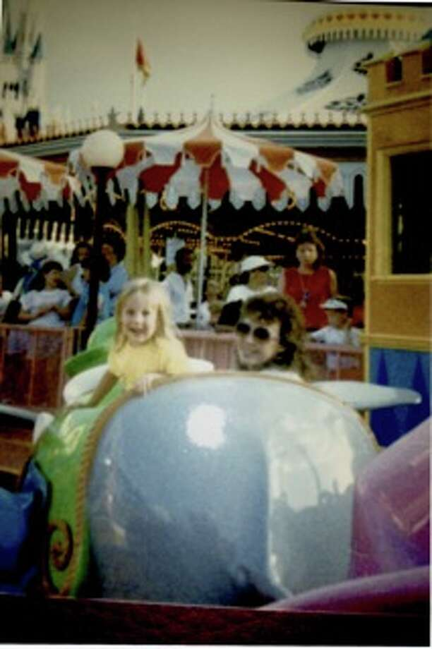 Then: Rhonda Empfield and Natalie Empfield Halladay at Magic Kingdom in Orlando, Florida on the Dumbo ride, 1988. Photo: Courtesy Photo / Rhonda Empfield